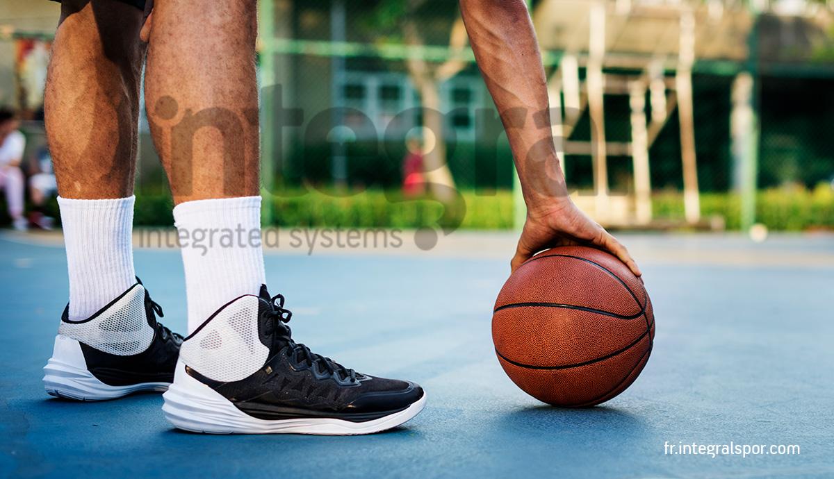 La réalisation d'un terrain de basketball